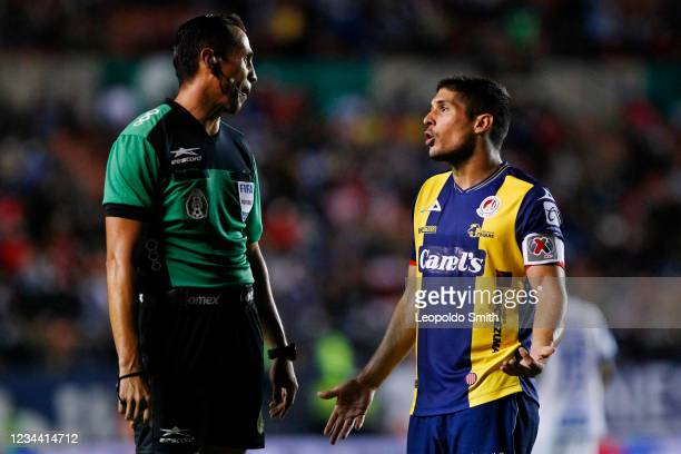 Javier Guemez of Atletico San Luis talks to referee Luis Enrique Santander during the second-round match against Queretaro in the Torneo Grita Mexico...