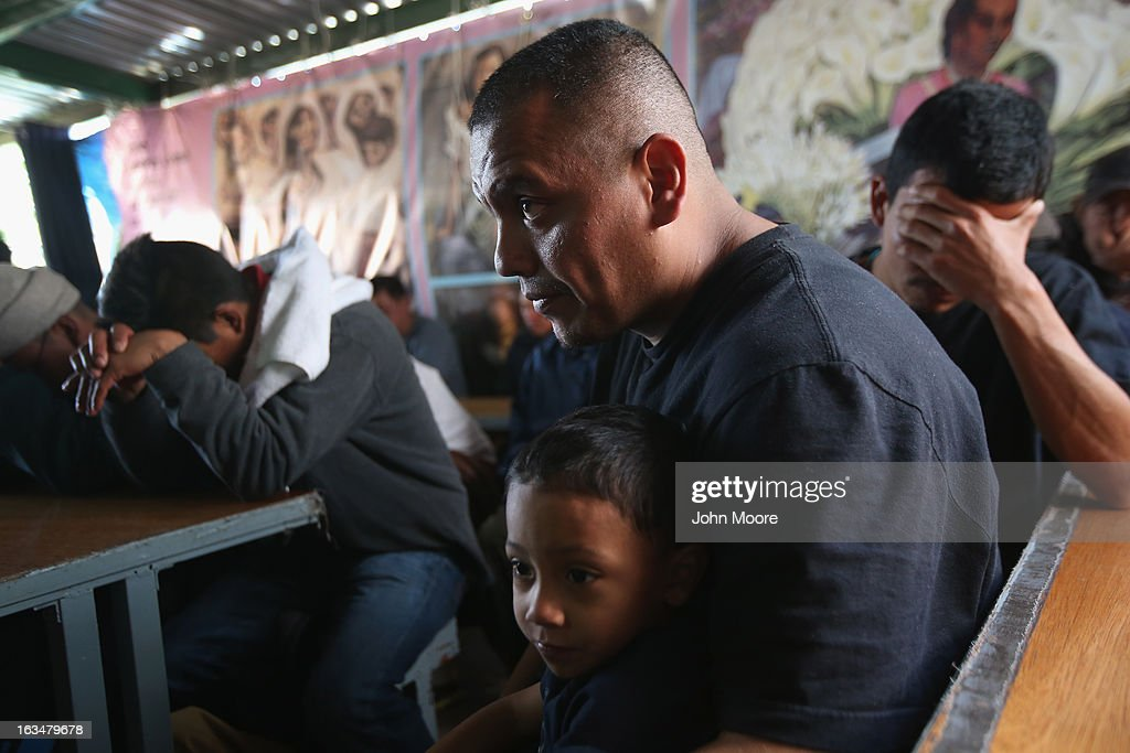 Javier Guerrero from Mexico attends a Catholic Mass with his visiting son, Javier Jr. (3), a U.S. citizen, at the Kino Border Initiative center for immigrants near the U.S.-Mexico border on March 10, 2013 in Nogales, Mexico. He is married to American citizen Lace Rodriguez, and the family had lived together in Phoenix. Guerrero, an undocumented worker from Mexico, said he was detained by the U.S. Border Patrol after being stopped for speeding and drug possession, held for three months by ICE and then deported March 4 to Nogales, Mexico. Guerrero had lived in the United States for 17 years. He and Rodriguez, a medical student, have two children, and she is nine-months pregnant with a third. The splitting up of families has become a major issue as the U.S. works towards immigration reform.