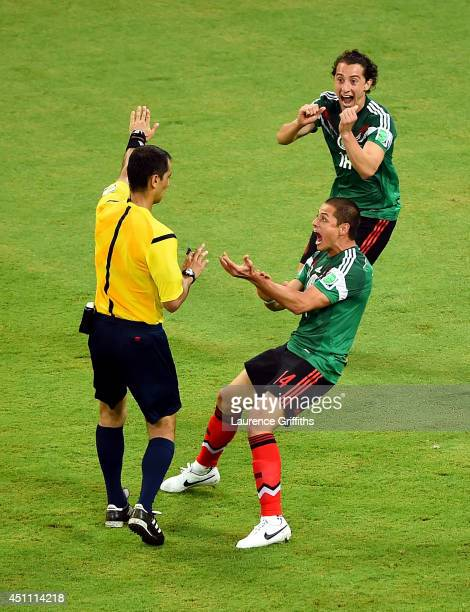 Javier Hernandez and Andres Guardado of Mexico appeal for a penalty during the 2014 FIFA World Cup Brazil Group A match between Croatia and Mexico at...