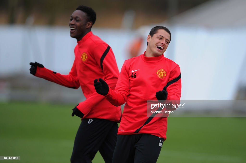 Javier Hernandez and Danny Welbeck share a joke during the Manchester United training ahead of their UEFA Europa League round of 32 second leg match against Ajax session at the Carrington Training Ground on February 22, 2012 in Manchester, England.