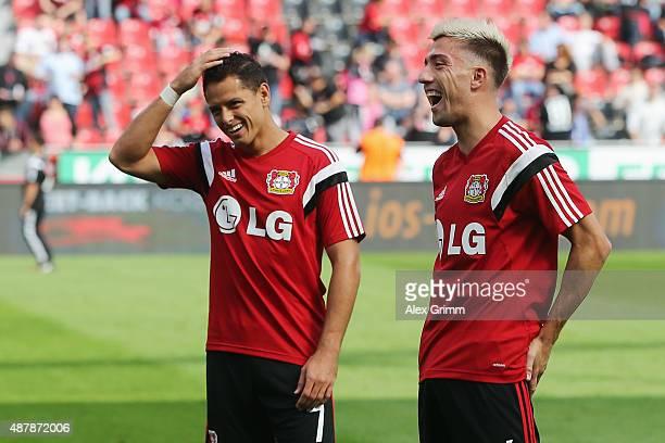 Javier Hernandez and Kevin Kampl of Leverkusen warm up prior to the Bundesliga match between Bayer Leverkusen and SV Darmstadt 98 at BayArena on...
