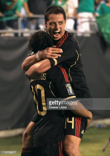 Javier Hernandez celebrates with teammate Giovani Dos Santos of Mexico after Dos Santos scored a goal against Cuba during their game in the CONCACAF...