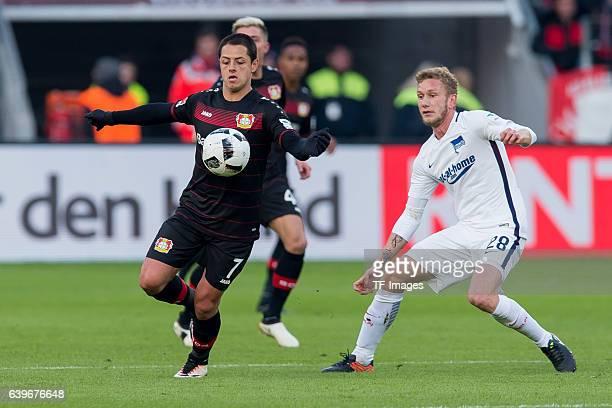 Javier Hernandez Chicharito of Leverkusen and Fabian Lustenberger of Berlin battle for the ball during the Bundesliga match between Bayer 04...