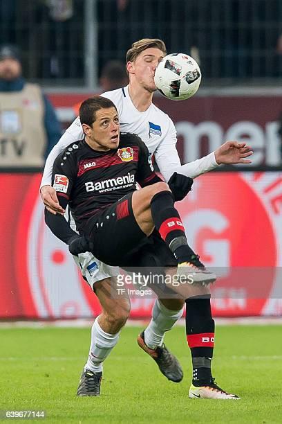Javier Hernandez Chicharito of Leverkusen and Niklas Stark of Berlin battle for the ball during the Bundesliga match between Bayer 04 Leverkusen and...