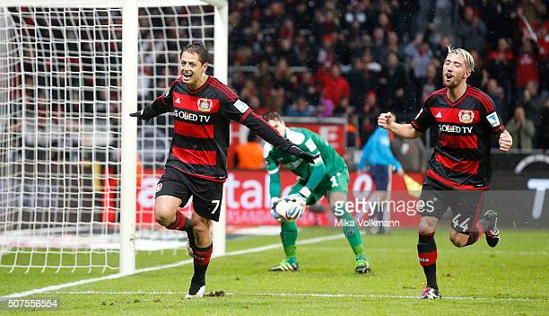 Javier Hernandez Chicharito of Leverkusen celebrates scoring the 20 goal with Kevin Kampl of Leverkusen during the Bundesliga match between Bayer...