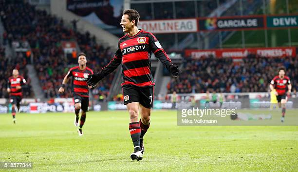 Javier Hernandez Chicharito of Leverkusen celebrates scoring the 20 goal while Dante of Wolfsburg lies on the field during the Bundesliga match...