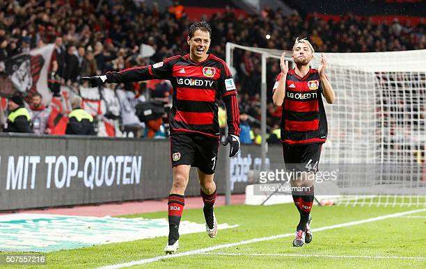 Javier Hernandez Chicharito of Leverkusen celebrates scoring their second goal with Kevin Kampl of Leverkusen during the Bundesliga match between...