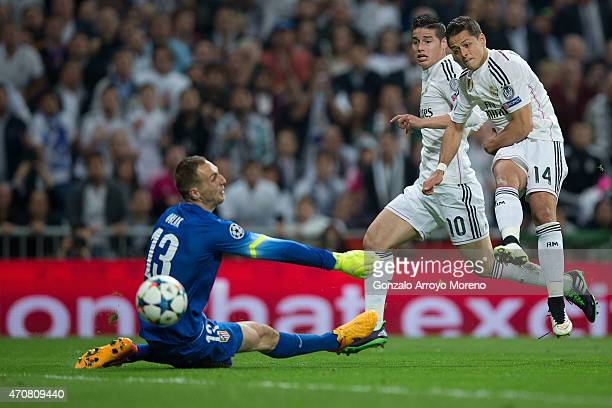 Javier Hernandez Chicharito of Real Madrid CF strikes the ball over goalkeeper Jan Oblak of Atletico de Madrid during the UEFA Champions League...