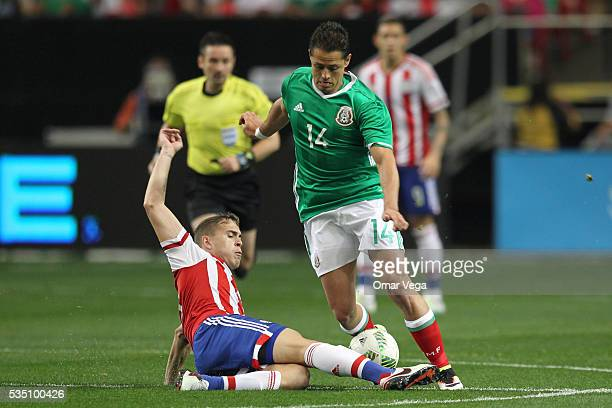 Javier Hernandez fights for the ball during the International Friendly between Mexico and Paraguay at Georgia Dome on May 28 2016 in Atlanta Georgia