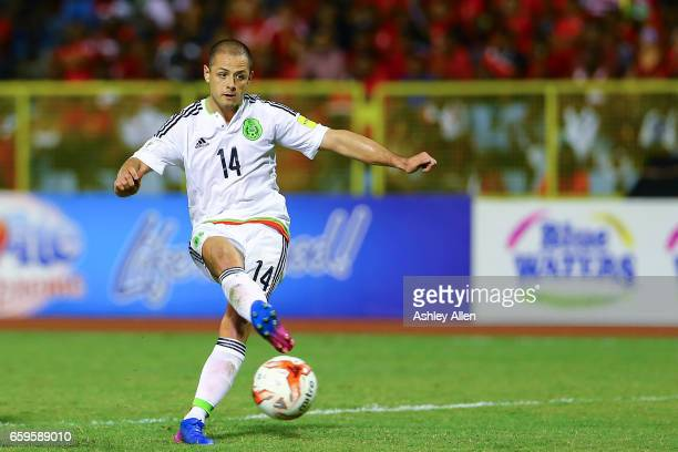 Javier Hernandez has a shot at goal during the fifth round match between Trinidad Tobago and Mexico as part of the FIFA 2018 World Cup Qualifiers at...