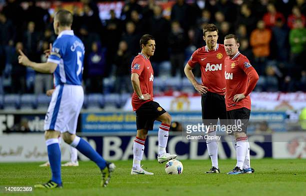 Javier Hernandez, Michael Carrick and Wayne Rooney wait to kick off after Wigan's goal during the Barclays Premier League match between Wigan...