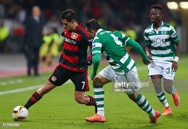 Javier Hernandez of Bayer Leverkusen and Jefferson of Sporting Lisbon compete for the ball during the UEFA Europa League round of 32 second leg match...