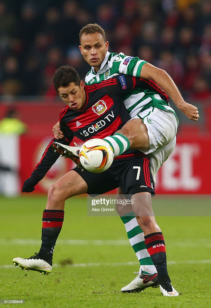 Javier Hernandez of Bayer Leverkusen controls the ball under pressure of Ewerton of Sporting Lisbon during the UEFA Europa League round of 32 second leg match between Bayer Leverkusen and Sporting Lisbon at BayArena on February 25, 2016 in Leverkusen, Germany.