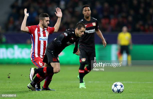 Javier Hernandez of Leverkusen and Koke of Atletico battle for the ball during the UEFA Champions League Round of 16 first leg match between Bayer...