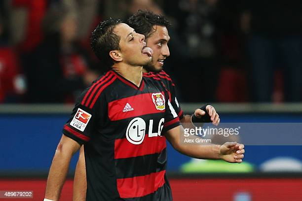 Javier Hernandez of Leverkusen celebrates his team's first goal with team mate Hakan Calhanoglu during the Bundesliga match between Bayer Leverkusen...