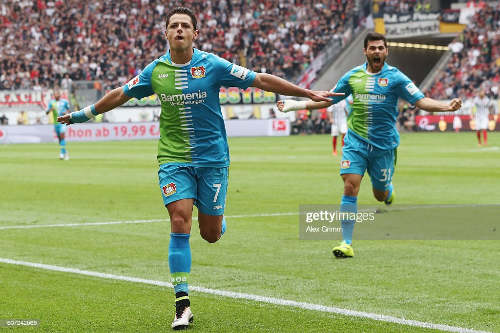Javier Hernandez (front) of Leverkusen celebrates his team's first goal with team mate Kevin Volland during the Bundesliga match between Eintracht Frankfurt and Bayer 04 Leverkusen at Commerzbank-Arena on September 17, 2016 in Frankfurt am Main, Germany.