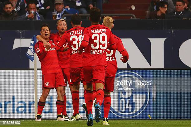 Javier Hernandez of Leverkusen celebrates his team's third goal with team mates during the Bundesliga match between FC Schalke 04 and Bayer...