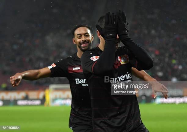 Javier Hernandez of Leverkusen celebrates scoring the second goal with Karim Bellarabi during the Bundesliga match between FC Augsburg and Bayer 04...