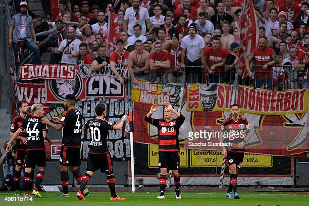 Javier Hernandez of Leverkusen celebrates with team mates in front of the Koeln stand after scoring his team's first goal during the Bundesliga match...