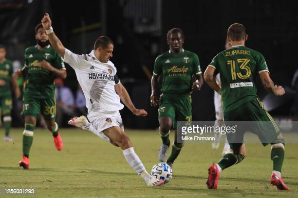 Javier Hernandez of Los Angeles Galaxy shoots during a match between Los Angeles Galaxy and Portland Timbers as part of MLS Is Back Tournament at...