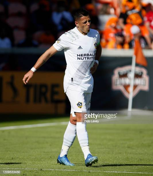 Javier Hernandez of Los Angeles Galaxy winces in pain as he takes a hard tackle against the Houston Dynamo during the first half at BBVA Stadium on...