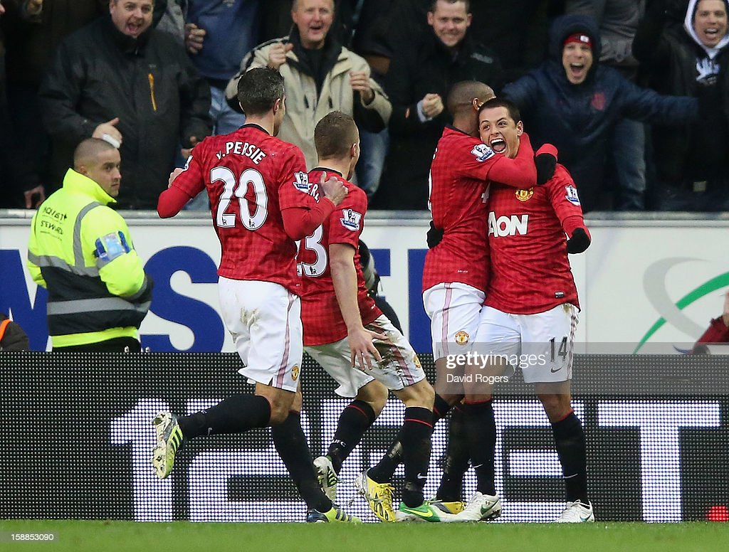 Javier Hernandez (R) of Machester United celebrates with team mates after scoring the first goal during the Barclays Premier League match between Wigan Athletic and Manchester United at the DW Stadium on January 1, 2013 in Wigan, England.