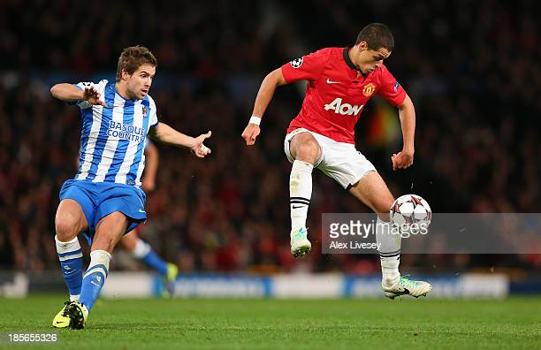Javier Hernandez of Manchester United beats Inigo Martinez of Real Sociedead to the ball during the UEFA Champions League Group A match between...