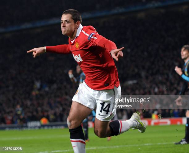 Javier Hernandez of Manchester United celebrates scoring his first goal during the UEFA Champions League round of 16 second leg match between...