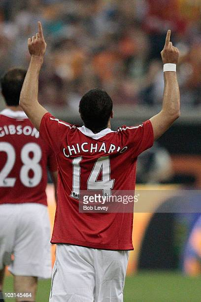 Javier Hernandez of Manchester United celebrates scoring his first goal with the club during the MLS All Star Game at Reliant Stadium on July 28,...