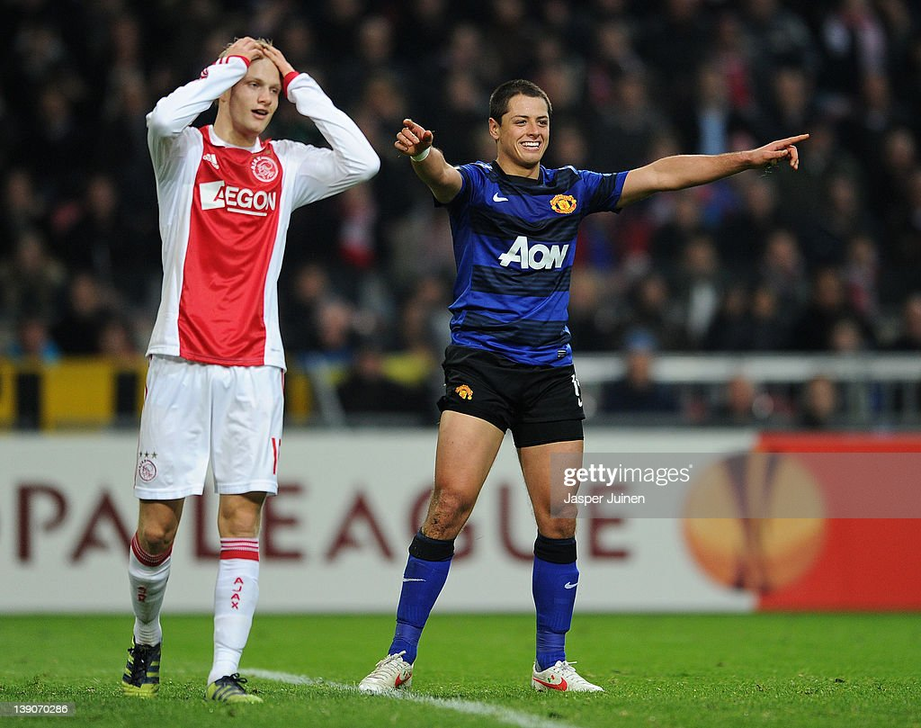 Javier Hernandez (R) of Manchester United celebrates scoring his sides second goal next to a dejected Nicolai Boilesen of Ajax Amsterdam during the UEFA Europa League round of 32 first leg match between Ajax and Manchester United at Amsterdam Arena on February 16, 2012 in Amsterdam, Netherlands.