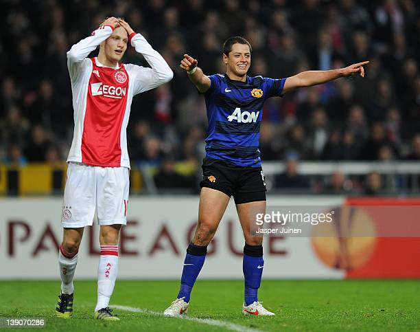 Javier Hernandez of Manchester United celebrates scoring his sides second goal next to a dejected Nicolai Boilesen of Ajax Amsterdam during the UEFA...