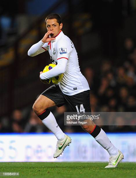 Javier Hernandez of Manchester United celebrates scoring his team's first goal during the Barclays Premier league match between Aston Villa and...