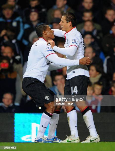 Javier Hernandez of Manchester United celebrates scoring his team's third goal with teammate Luis Antonio Valencia during the Barclays Premier league...