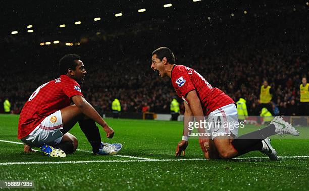 Javier Hernandez of Manchester United celebrates scoring his team's third goal with teammate Anderson to make the score 31 during the Barclays...