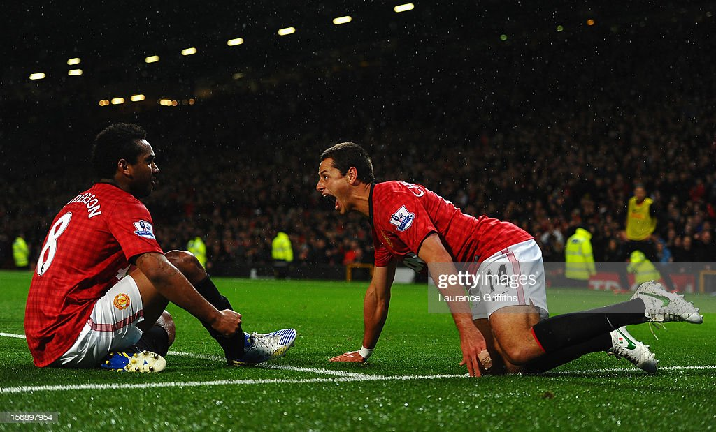 Javier Hernandez of Manchester United celebrates scoring his team's third goal with team-mate Anderson (L) to make the score 3-1 during the Barclays Premier League match between Manchester United and Queens Park Rangers at Old Trafford on November 24, 2012 in Manchester, England.