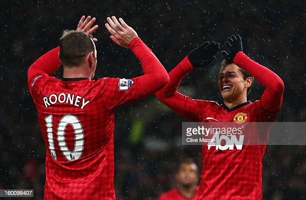 Javier Hernandez of Manchester United celebrates scoring his team's third goal with teammate Wayne Rooney during the FA Cup with Budweiser Fourth...