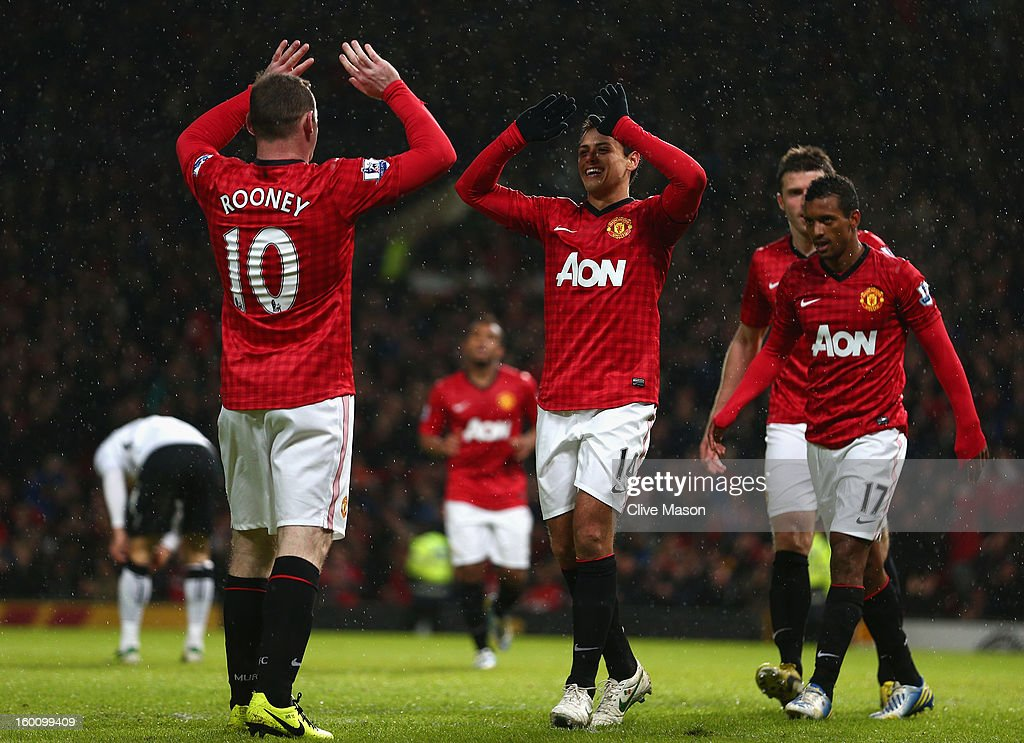 Javier Hernandez of Manchester United celebrates scoring his team's third goal with team-mate Wayne Rooney during the FA Cup with Budweiser Fourth Round match between Manchester United and Fulham at Old Trafford on January 26, 2013 in Manchester, England.