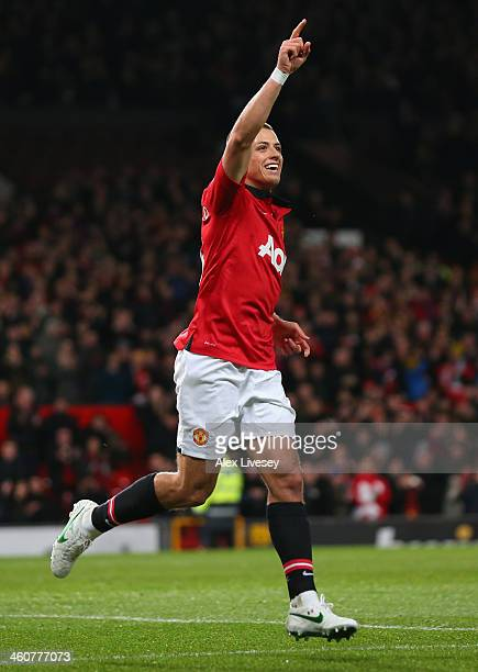 Javier Hernandez of Manchester United celebrates scoring his team's first goal during the FA Cup with Budweiser Third round match between Manchester...