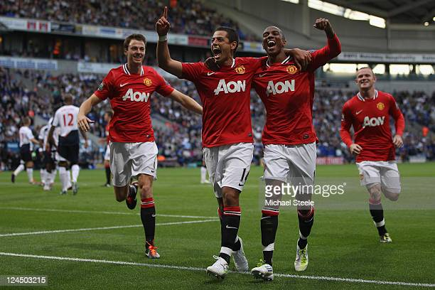 Javier Hernandez of Manchester United celebrates scoring the fourth goal with Ashley Young and Johnny Evans during the Barclays Premier League at the...