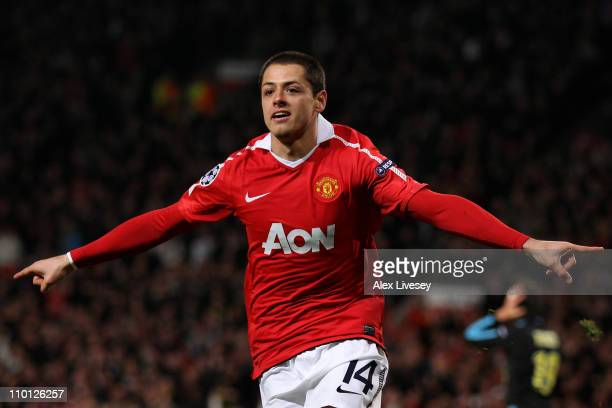 Javier Hernandez of Manchester United celebrates scoring the opening goal during the UEFA Champions League round of 16 second leg match between...