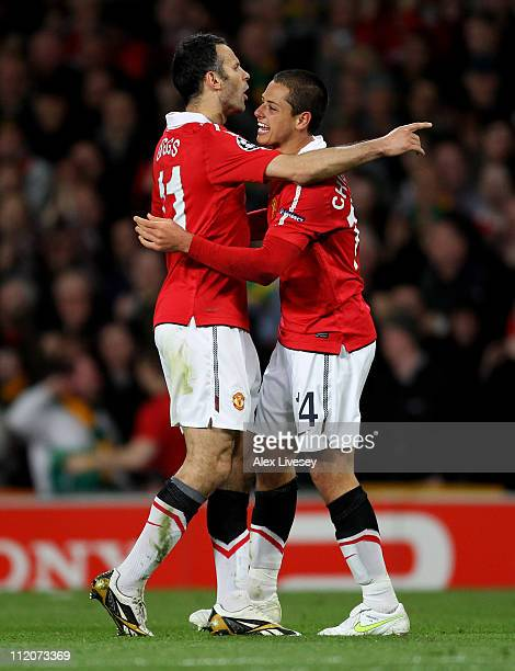 Javier Hernandez of Manchester United celebrates scoring the opening goal with team mate Ryan Giggs during the UEFA Champions League Quarter Final...