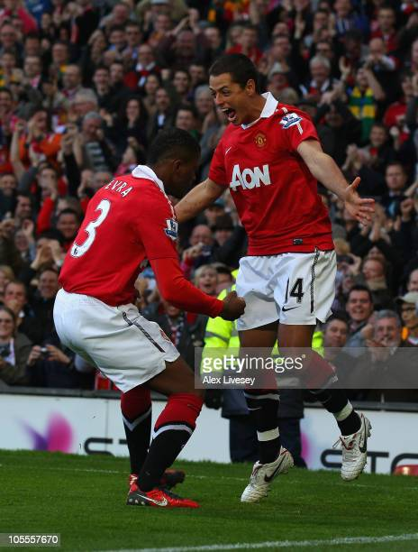 Javier Hernandez of Manchester United celebrates with Patrice Evra after scoring the first goal during the Barclays Premier League match between...