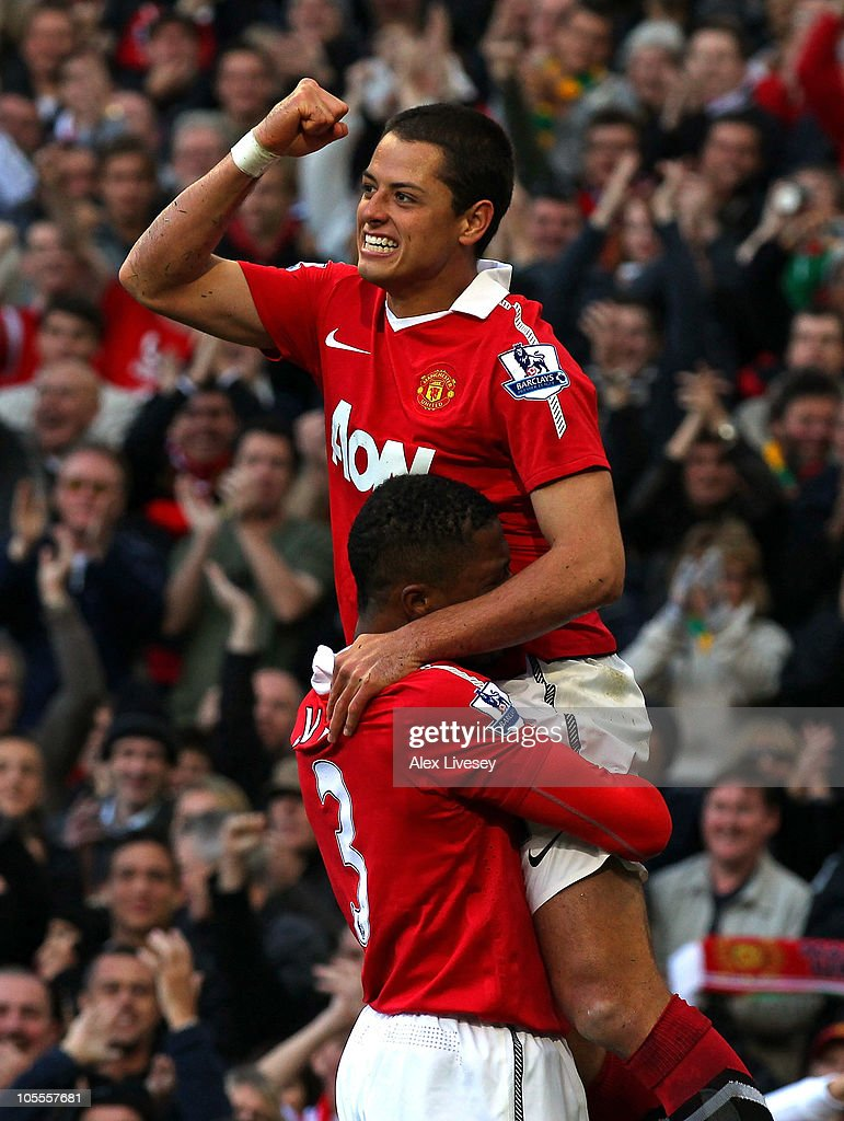 Javier Hernandez of Manchester United celebrates with Patrice Evra after scoring the first goal during the Barclays Premier League match between Manchester United and West Bromwich Albion at Old Trafford on October 16, 2010 in Manchester, England.