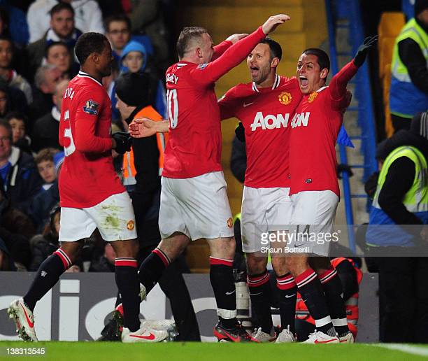 Javier Hernandez of Manchester United celebrates with team mates as he scores their third goal with a header during the Barclays Premier League match...