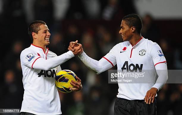 Javier Hernandez of Manchester United celebrates with team-mate Luis Antonio Valencia at the end of the Barclays Premier league match between Aston...