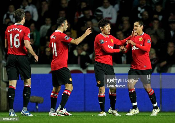 Javier Hernandez of Manchester United celebrates with teammates after scoring the opening goal during the Barclays Premier League match between...