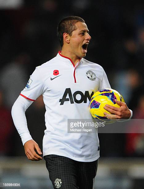 Javier Hernandez of Manchester United celebrates with the match ball at the end of the Barclays Premier league match between Aston Villa and...