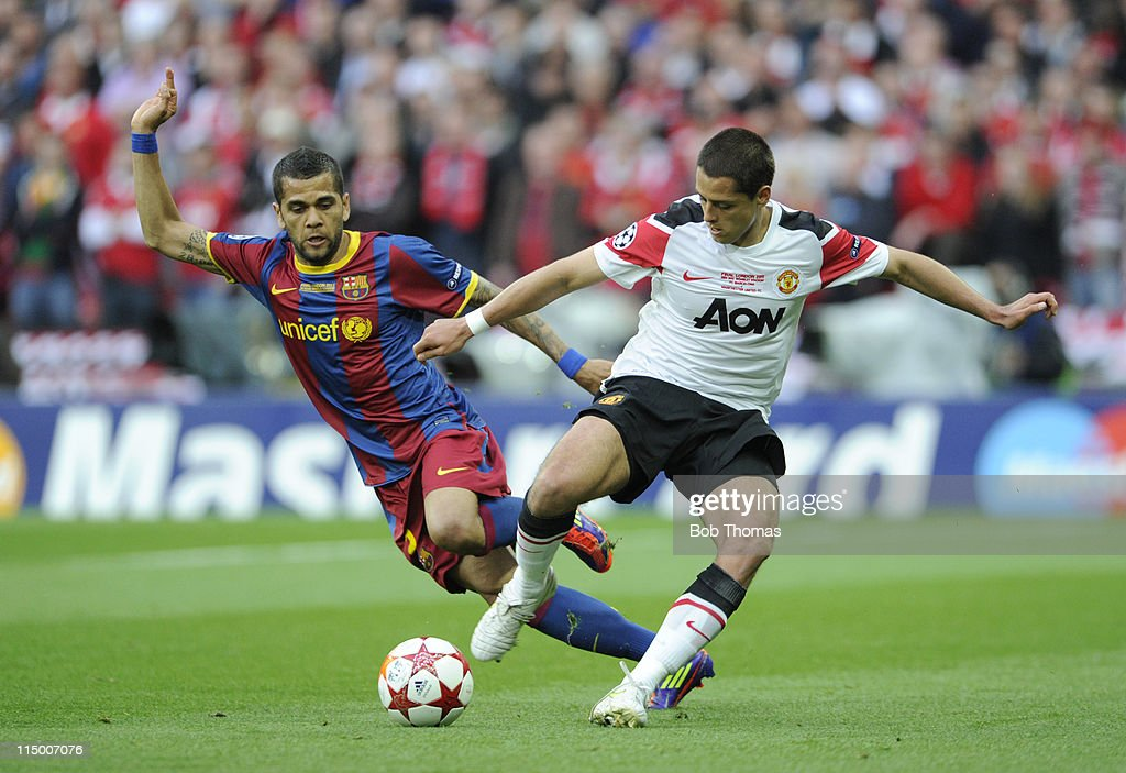Javier Hernandez of Manchester United challenged by Daniel Alves of Barcelona during the UEFA Champions League final between FC Barcelona and Manchester United FC at Wembley Stadium on May 28, 2011 in London, England. Barcelona won the match 3-1.