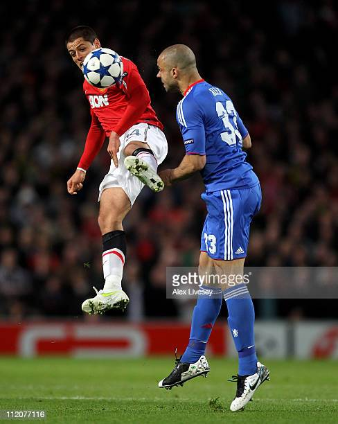 Javier Hernandez of Manchester United competes with Alex of Chelsea during the UEFA Champions League Quarter Final second leg match between...