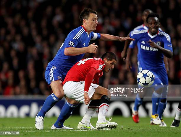 Javier Hernandez of Manchester United competes with John Terry of Chelsea during the UEFA Champions League Quarter Final second leg match between...
